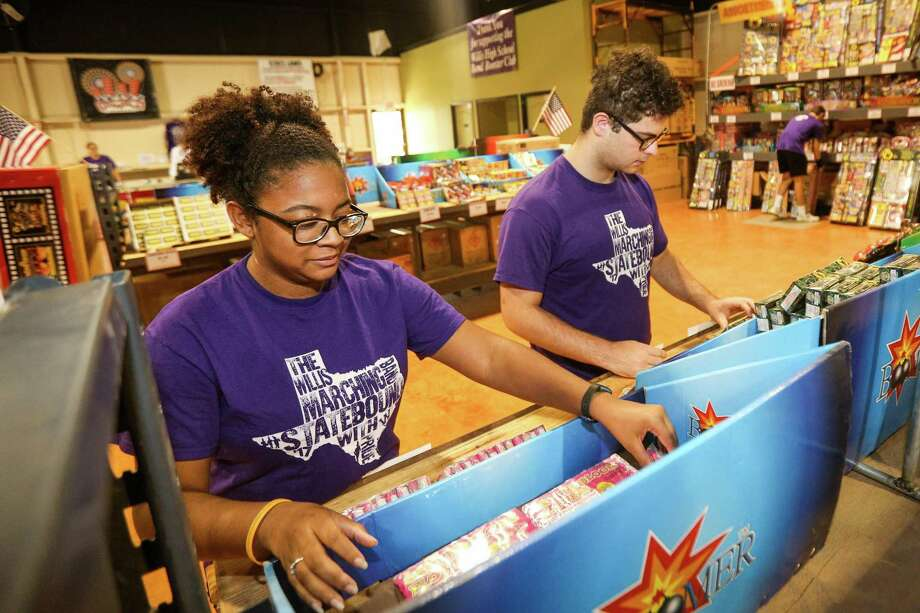 Willis senior Nyesha McElroy, left, and Willis junior Blaine Munguia, both band members, organize fireworks on Sunday, July 1, 2018, at Boomtown Fireworks in Willis. Sales from Boomtown Fireworks benefit the Willis High School Band Booster Club. Photo: Michael Minasi, Staff Photographer / Houston Chronicle / © 2018 Houston Chronicle
