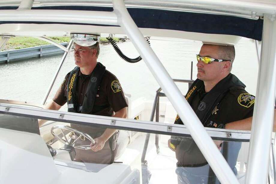Huron County Sheriff Kelly J. Hanson (left) and Undersheriff Duane Miller set out on Lake Huron on Saturday to patrol the waters in the department's Grady-White boat. (Coulter Mitchell/For the Tribune)