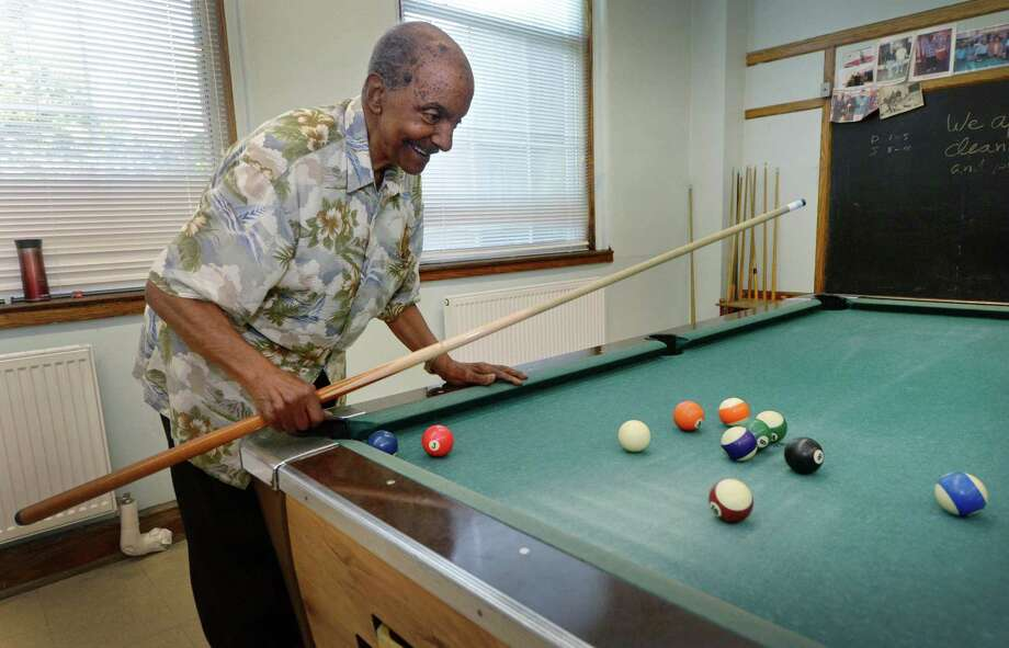 Norwalk native Tam Dickson plays pool at Norwalk Senior Center Thursday, June 28, 2018, in Norwalk, Conn. Dickson has been shooting pool with the same three friends every weekday for years andrecently celebrated his 90th birthday with them at the Norwalk Senior Center, where pictures of him with nationally renowned pool players decorate the walls. Photo: Erik Trautmann / Hearst Connecticut Media / Norwalk Hour