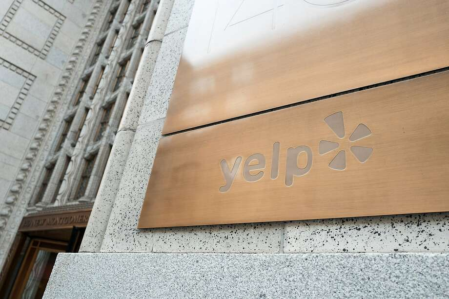 FILE-- Sign at the headquarters of social reviews site Yelp in the South of Market (SoMa) neighborhood of San Francisco Oct. 13, 2017.Yelp was crashing Friday morning, down more than 30%, after reporting third-quarter results and full-year guidance that were well short of expectations. Photo: Smith Collection/Gado, Getty Images