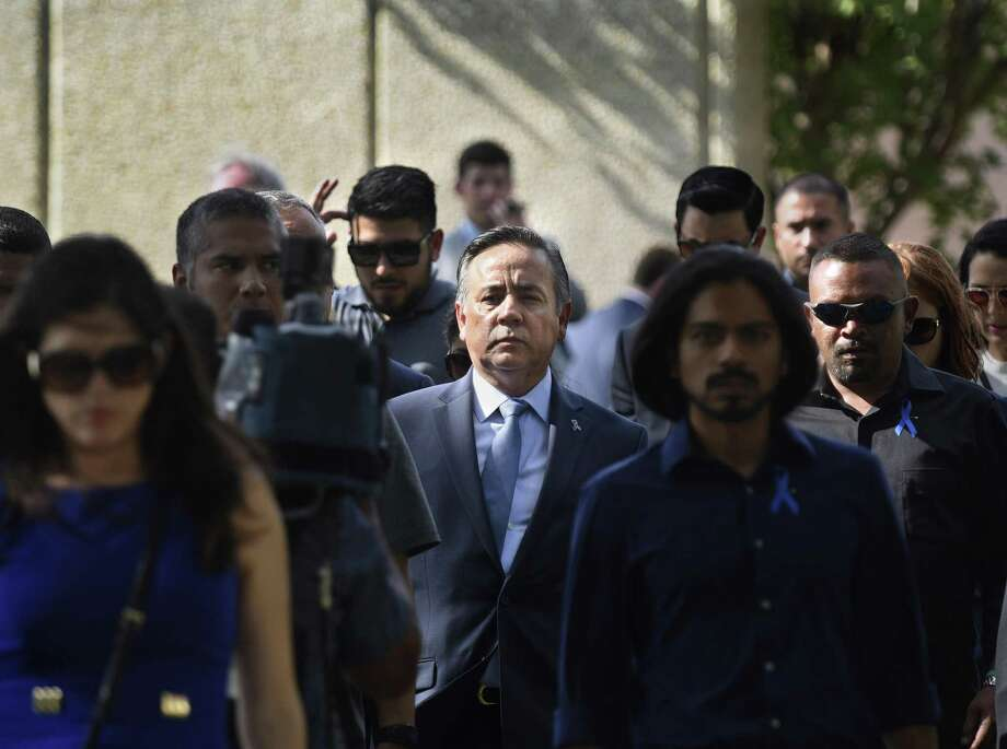 Former state Sen. Carlos Uresti's Helotes estate was pulled from Tuesday's foreclosure auction. Uresti is shown in June leaving the San Antonio federal courthouse surrounded by a crowd of supporters after being sentenced in the FourWinds Logistics fraud case. Photo: Billy Calzada /Staff File Photo / San Antonio Express-News