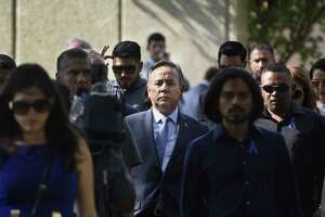 Early voting begins Monday in the special election to fill the the state Senate seat vacated by Carlos Uresti (center), seen leaving the federal courthouse in San Antonio on June 26 after receiving a 12-year sentence for fraud.