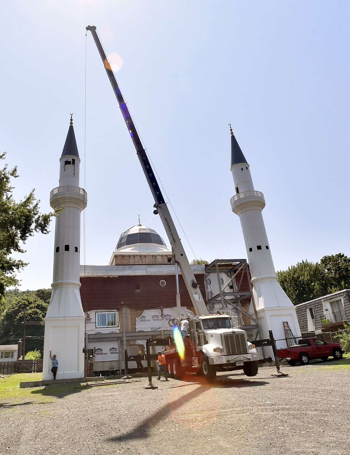 Minarets at a mosque on Middletown Avenue in New Haven were being shortened Monday to comply with zoning regulations.