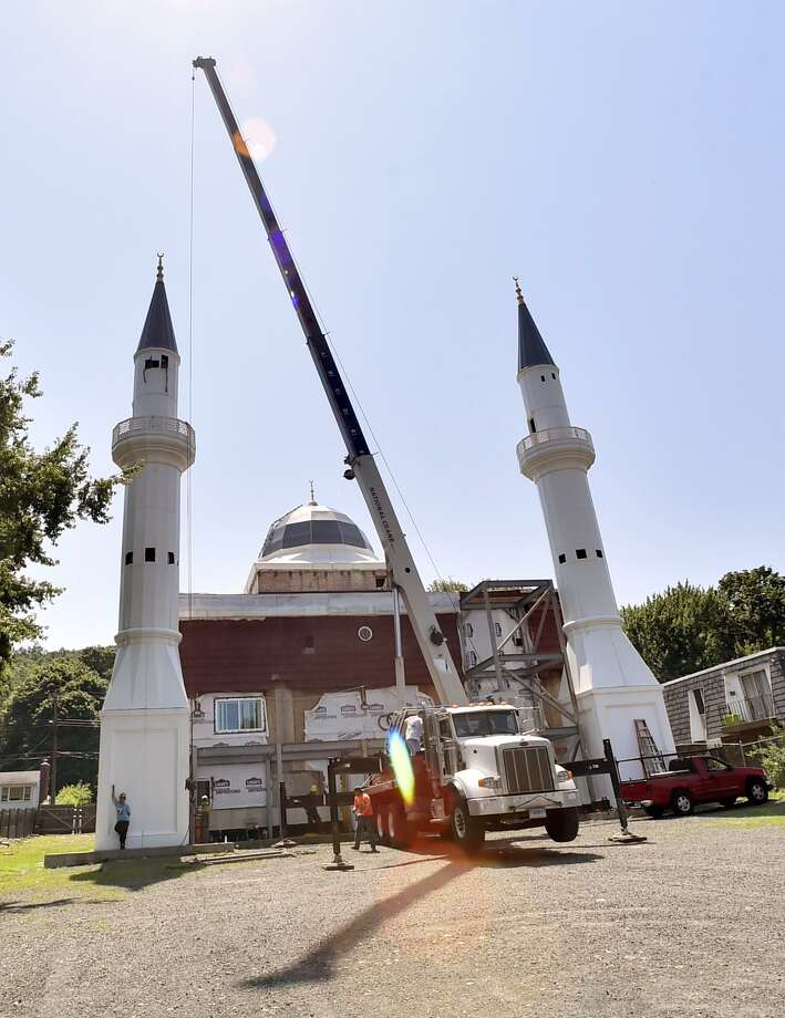 Minarets at  a mosque on Middletown Avenue in New Haven were being shortened Monday to comply with zoning regulations. Photo: Peter Hvizdak / Hearst Connecticut Media / New Haven Register