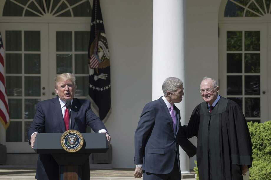 With the retirement of Justice Anthony Kennedy, right, President Trump will get two Supreme Court nominations. The first was Neil Gorsuch, middle, for whom Kennedy administered the oath of office April 10, 2017. Photo: STEPHEN CROWLEY /NYT / NYTNS