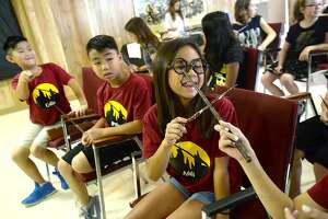 Addi Tran laughs as she and friend Kasey Truong (out of frame, right) get into a battle of the wands as they learn spells during the opening week of the Wizard Summer Camp at the Clifton Steamboat Museum. The camp runs Monday - Thursday from 9 a.m. - 1 p.m., with a number of Harry Potter themed activities planned, including wand making, spells and potions, games, crafts, and weather - permitting quidditch. Spots are still available for the 4th and 5th weeks of camp. Friday, July 2, 2018 Kim Brent/The Enterprise