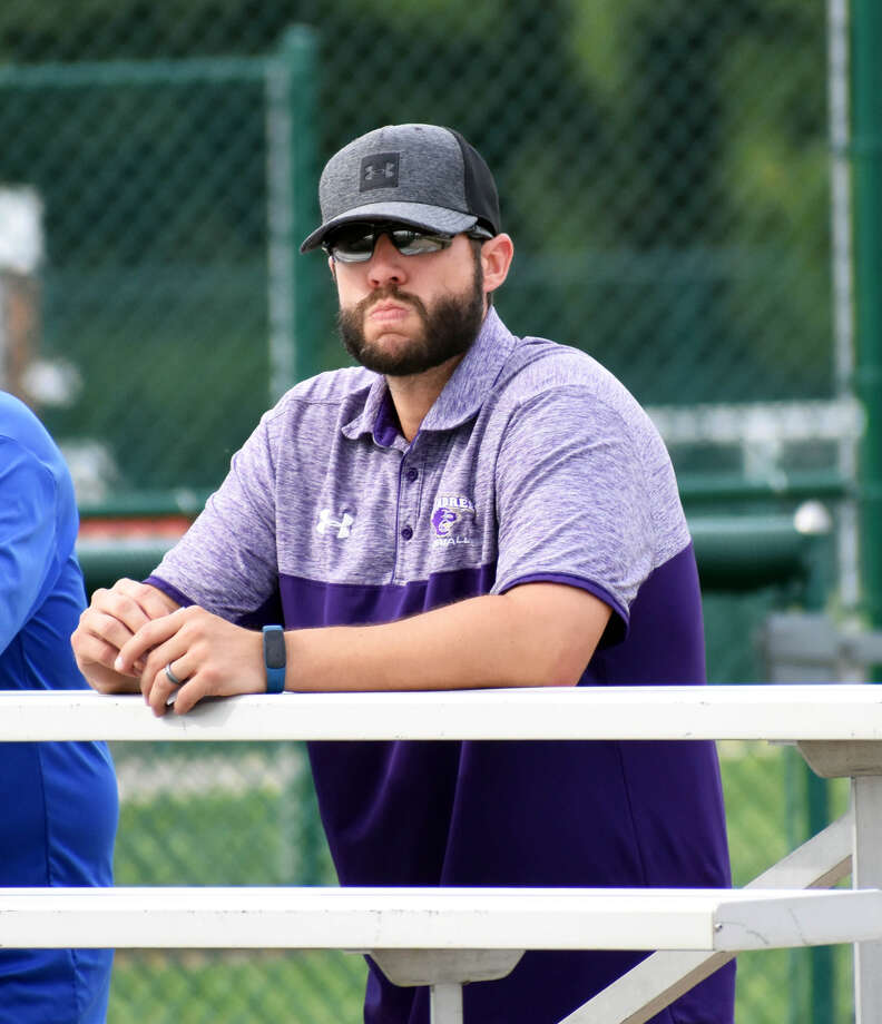 Former Edwardsville standout and current McKendree manager Danny Jackson watches EHS play in a tournament game on Friday inside the District 7 Sports Complex.
