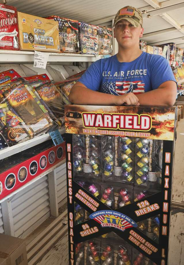 Carson Martin shows off one of the larger sets of fireworks for sale 07/02/18 at the Mr. W's Fireworks off S. Rankin Hwy run by the MHS Air Force JROTC students to help raise money for the program. Tim Fischer/Reporter-Telegram Photo: Tim Fischer/Midland Reporter-Telegram