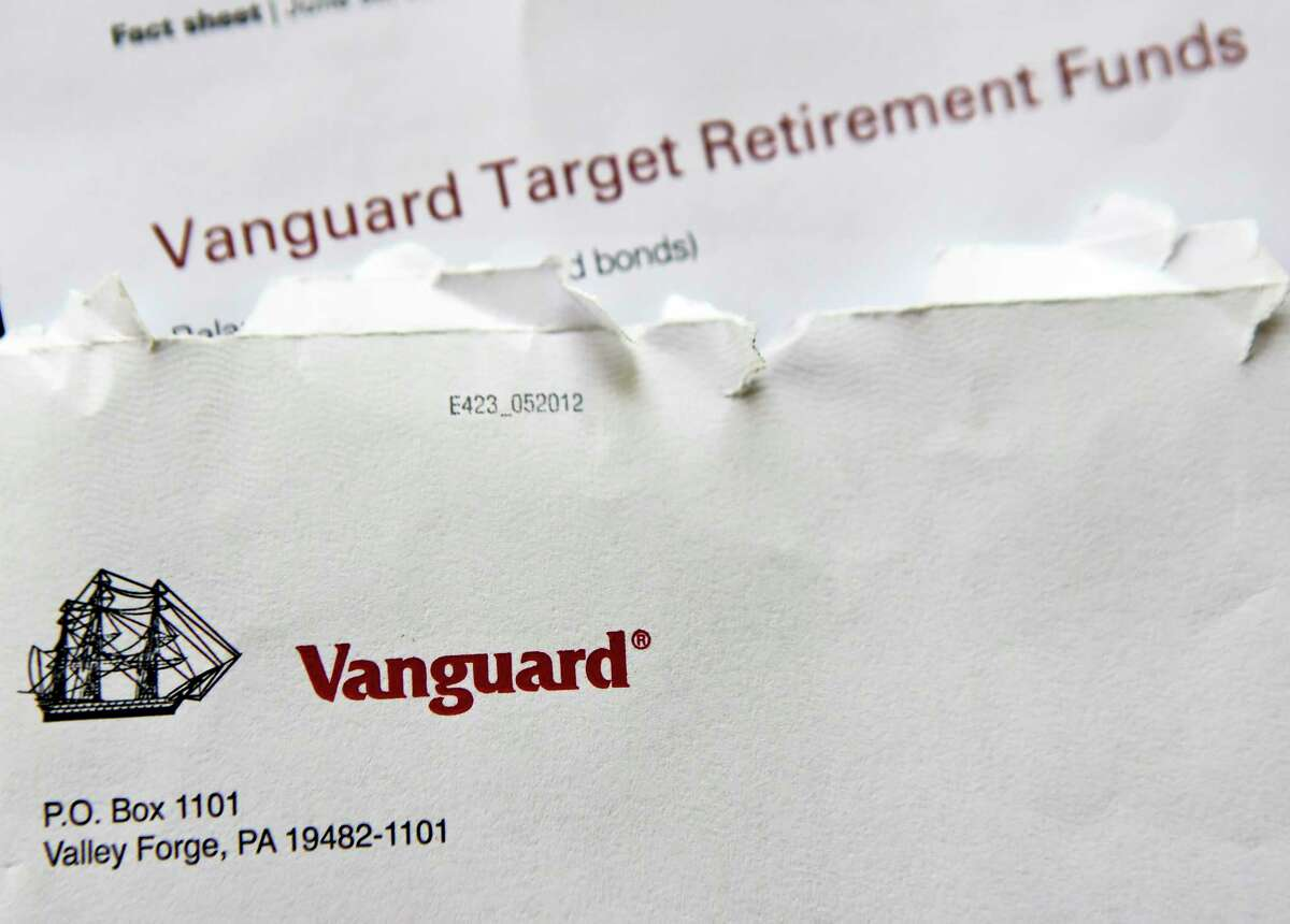 In this June 7, 2018, photo the logo for the Vanguard Group is shown on correspondence in Zelienople, Pa. Vanguard said Monday, July 2, that it will stop charging commissions to trade most of its competitors?' exchange-traded funds. (AP Photo/Keith Srakocic)