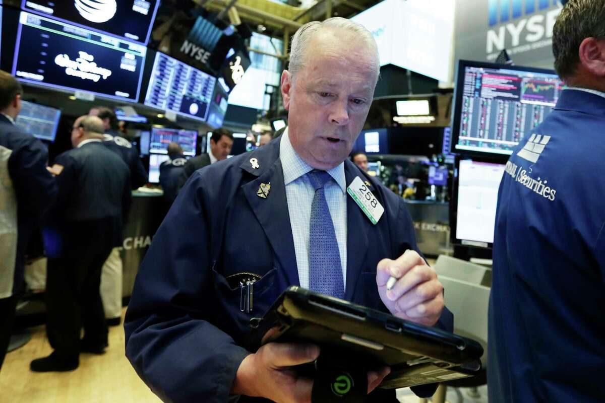 Trader James Riley works on the floor of the New York Stock Exchange, Monday, July 2, 2018. U.S. stocks are falling Monday amid weak economic data from Asia and an election result in Mexico that's likely to complicate talks on renegotiating the NAFTA trade agreement. (AP Photo/Richard Drew)