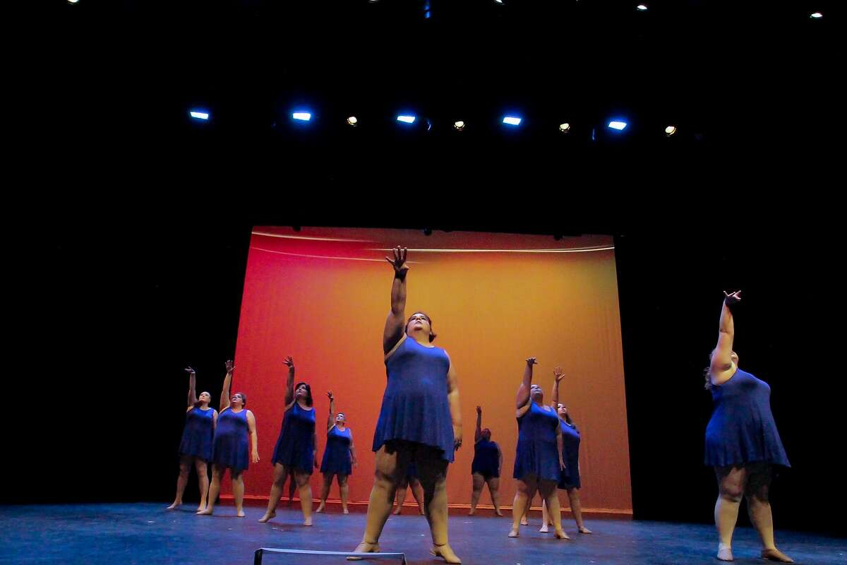 Dancers perform in