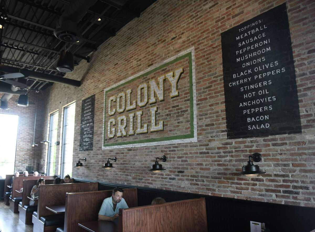 Folks eat at Colony Grill in Port Chester, N.Y. Monday, July 2, 2018.