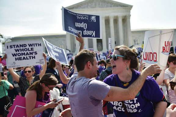 (FILES) In this file photo taken on June 27, 2016 abortion rights activists embrace after the US Supreme Court struck down a Texas law placing restrictions on abortion clinics, outside of the Supreme Court in Washington, DC. Access to abortion and health care will be at the heart of the looming battle over the appointment of a new Supreme Court justice, with all eyes on a handful of senators with the power to endorse, or block, President Donald Trump's choice. Democrats are hoping to prevent Trump from tilting the court to the hard right by tapping an ultra-conservative to replace Justice Anthony Kennedy, the tie-breaking vote between the liberals and conservatives on the nine-seat bench who retires at the end of July.  / AFP PHOTO / MANDEL NGANMANDEL NGAN/AFP/Getty Images