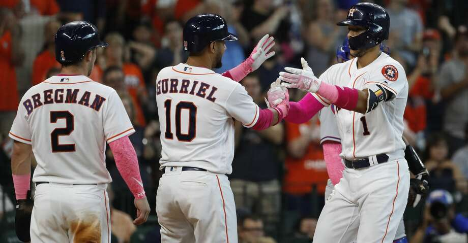 Houston Astros Carlos Correa (1) celebrates his home run with Yuli Gurriel (10) and Alex Bregman (2) during the seventh inning of an MLB game at Minute Maid Park, Sunday, May 13, 2018, in Houston. ( Karen Warren  / Houston Chronicle ) Photo: Karen Warren/Houston Chronicle