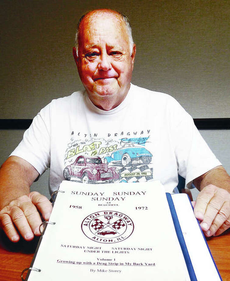 "Mike Storey of Alton with prototype of his soon-to-be released, ""Sunday Sunday Sunday"" book on the former Alton Dragway. He is wearing a 1992 T-shirt commemorating 20 years since the track closed that he reproduced and also is selling along with the book. Photo:       Linda N. Weller 
