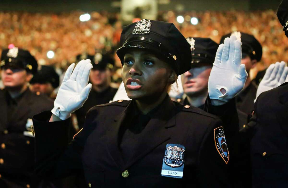 Members of New York Police Academy's July 2018 graduating class of 726 new NYPD police officers, pledge the Oath of Office during graduation ceremony, Monday July 2, 2018, in New York. (AP Photo/Bebeto Matthews)