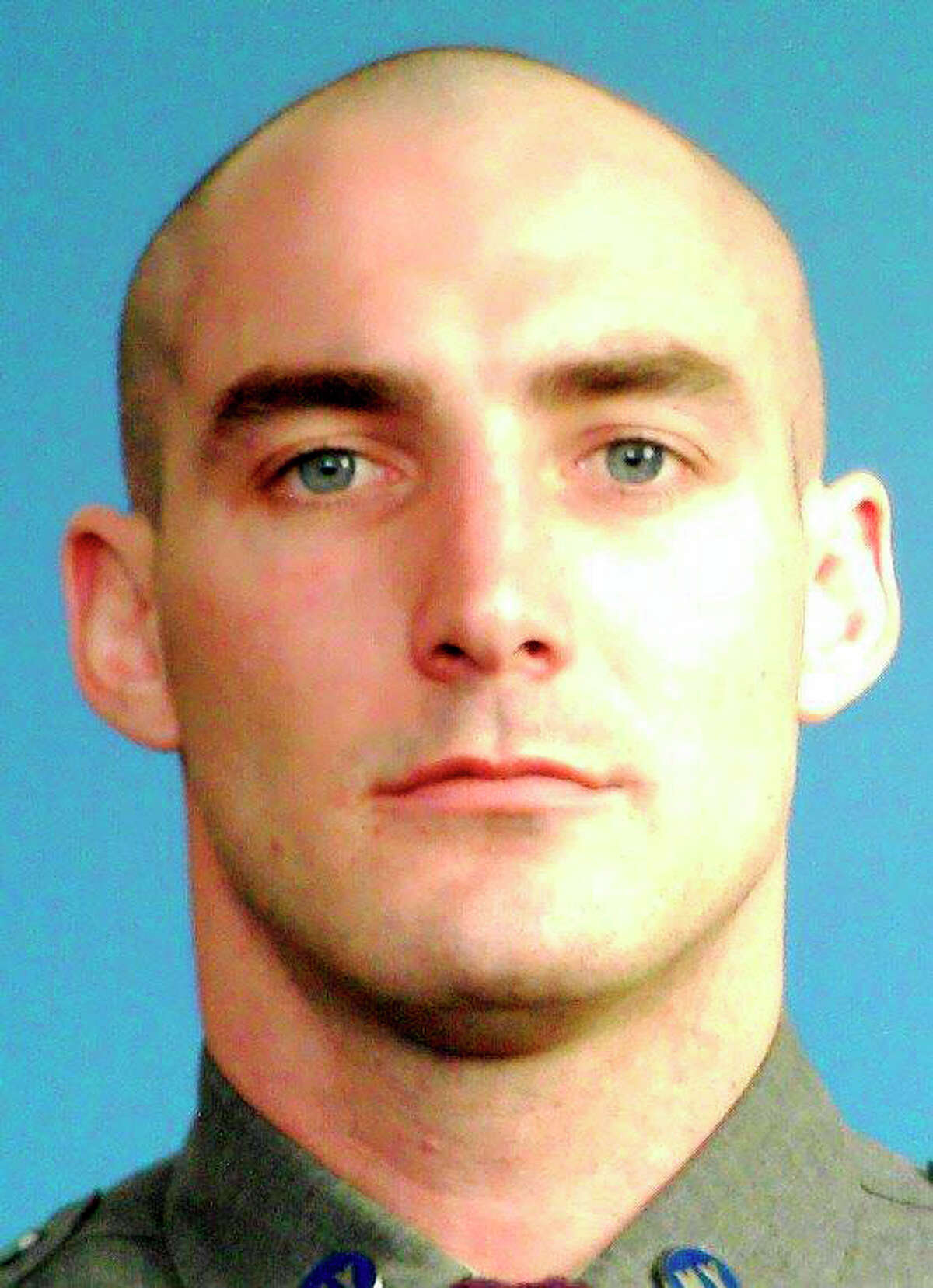This undated photo provided by the New York State Police shows Trooper Nicholas F. Clark, who was killed on Monday morning, July 2, 2018, while responding to a domestic dispute south of the city of Corning, near the Pennsylvania state line. A procession of dozens of state police cars with lights flashing followed the coroner's vehicle on Route 17 carrying the body of the fallen trooper to Lourdes Hospital in Binghamton. This marks the second time a New York state trooper was killed responding to a domestic call in just under a year. (New York State Police via AP)
