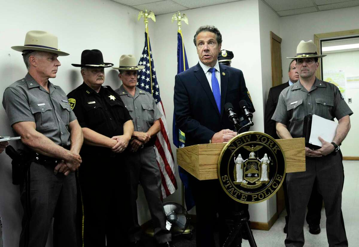 Gov. Andrew Cuomo talks to reporters about the death of New York State Trooper Nicholas Clark at the state police barracks in Painted Post, N.Y., , Monday, July 2, 2018. Clark, 29, was shot and killed early Monday after responding to a suicidal person barricaded inside his Erwin, N.Y., residence. (AP Photo/Heather Ainsworth)