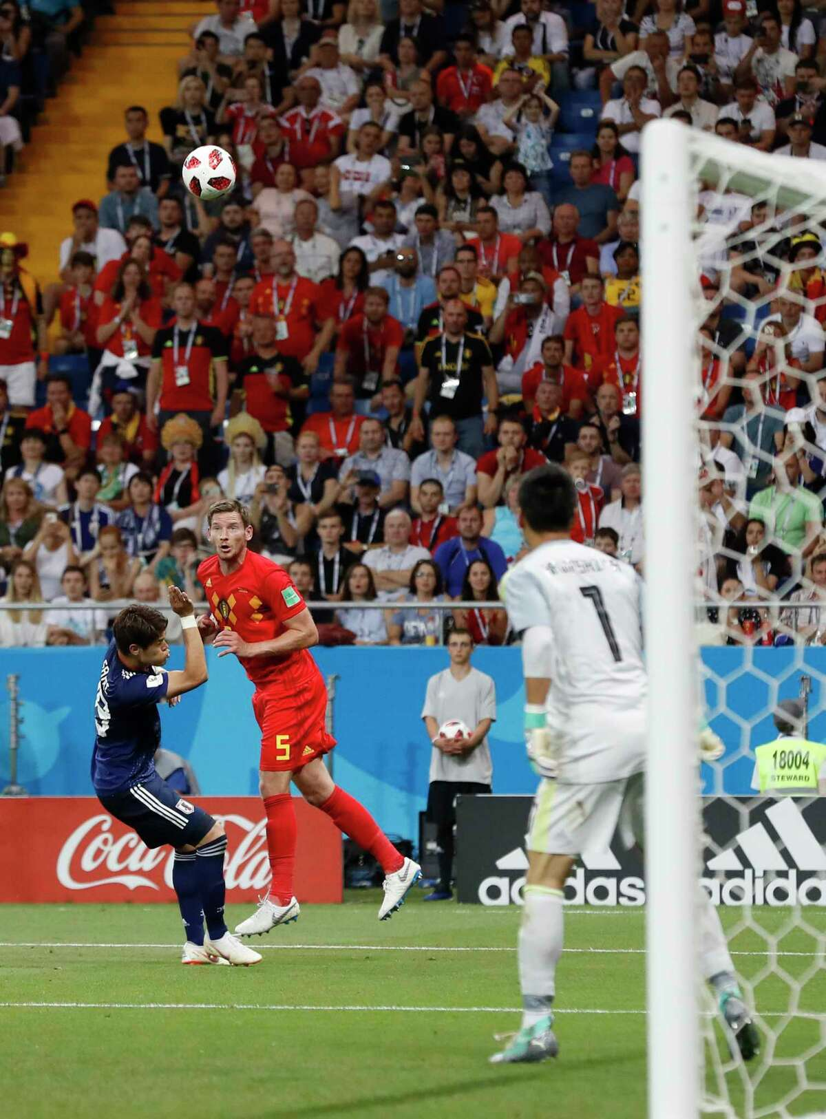 Belgium's Jan Vertonghen, second left, heads the ball to score his side's first goal during the round of 16 match between Belgium and Japan at the 2018 soccer World Cup in the Rostov Arena, in Rostov-on-Don, Russia, Monday, July 2, 2018. (AP Photo/Rebecca Blackwell)
