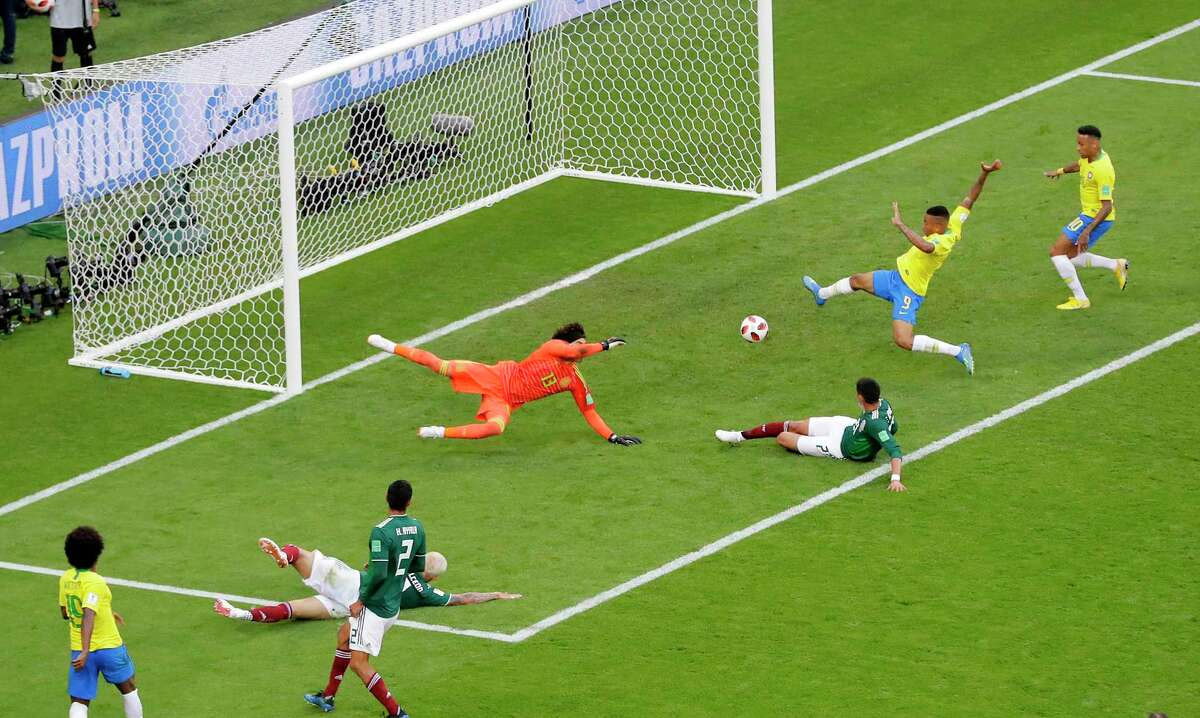 Brazil's Neymar, right, prepares to kick the ball and score during the round of 16 match between Brazil and Mexico at the 2018 soccer World Cup in the Samara Arena, in Samara, Russia, Monday, July 2, 2018. (AP Photo/Sergei Grits)