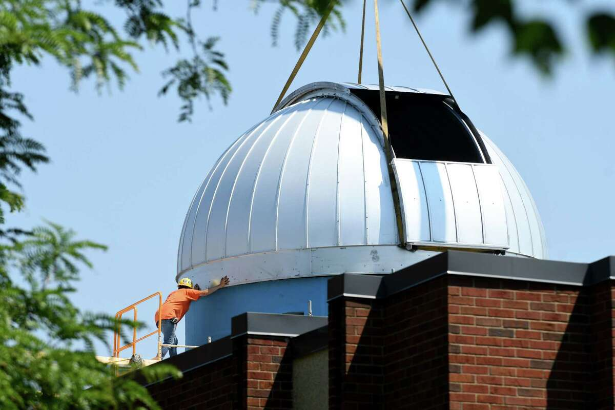 The dome for Siena College's new observatory is lowered onto its housing on the roof of Roger Bacon Hall on Monday, July 2, 2018, in Albany, N.Y. The dome weighs 2,200 pounds and was assembled onsite. The structure is scheduled for completion in August, and will house the largest telescope in the Capital Region, according to Siena. (Will Waldron/Times Union)