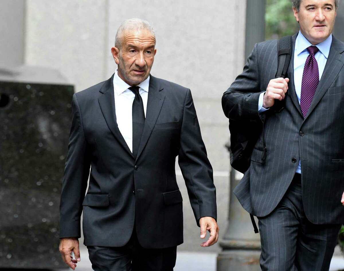 Alain Kaloyeros, former president of the State University of New York's Polytechnic Institute, left, arrives at federal court in New York, U.S., on Tuesday, June 19, 2018. Kaloyeros is accused of conspiring with construction and real estate executives from COR Development in Syracuse and LPCiminelli in Buffalo to rig bids for lucrative projects in Buffalo and Syracuse tied to the Buffalo Billion project, a New York state government project led by Governor Andrew Cuomo. Photographer: Louis Lanzano/Bloomberg