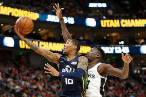 Utah Jazz guard Jairus Lyles (18) lays the ball up as San Antonio Spurs center Amida Brimah, right, defends during the first half of an NBA summer league basketball game Monday, July 2, 2018, in Salt Lake City. (AP Photo/Rick Bowmer)