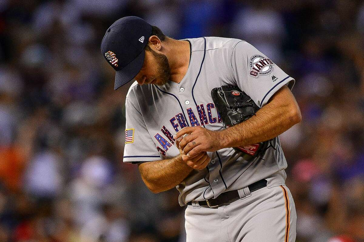 DENVER, CO - JULY 2: Madison Bumgarner #40 of the San Francisco Giants takes a moment after allowing the Colorado Rockies to load the bases in the seventh inning of a game at Coors Field on July 2, 2018 in Denver, Colorado. (Photo by Dustin Bradford/Getty Images)