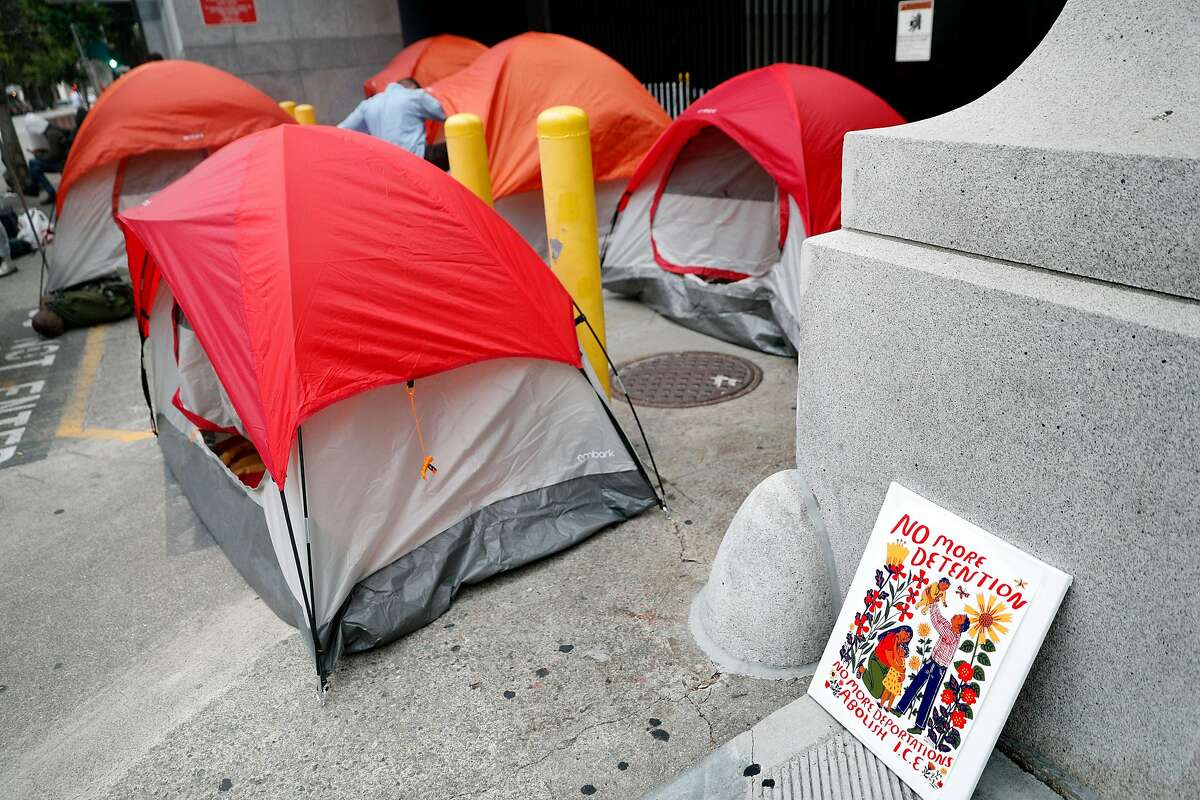 """A sign reading, """"No More Detention"""" sits next to a camp set up by several dozen Occupy protesters outside the U.S. Citizenship and Immigration Services building to block Immigration and Customs Enforcement agents' access in San Francisco, Calif., on Monday, July 2, 2018."""