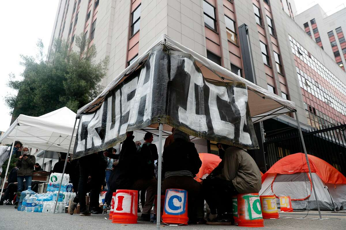 Several dozen Occupy protesters set up a camp outside the U.S. Citizenship and Immigration Services building to block Immigration and Customs Enforcement agents' access in San Francisco, Calif., on Monday, July 2, 2018.