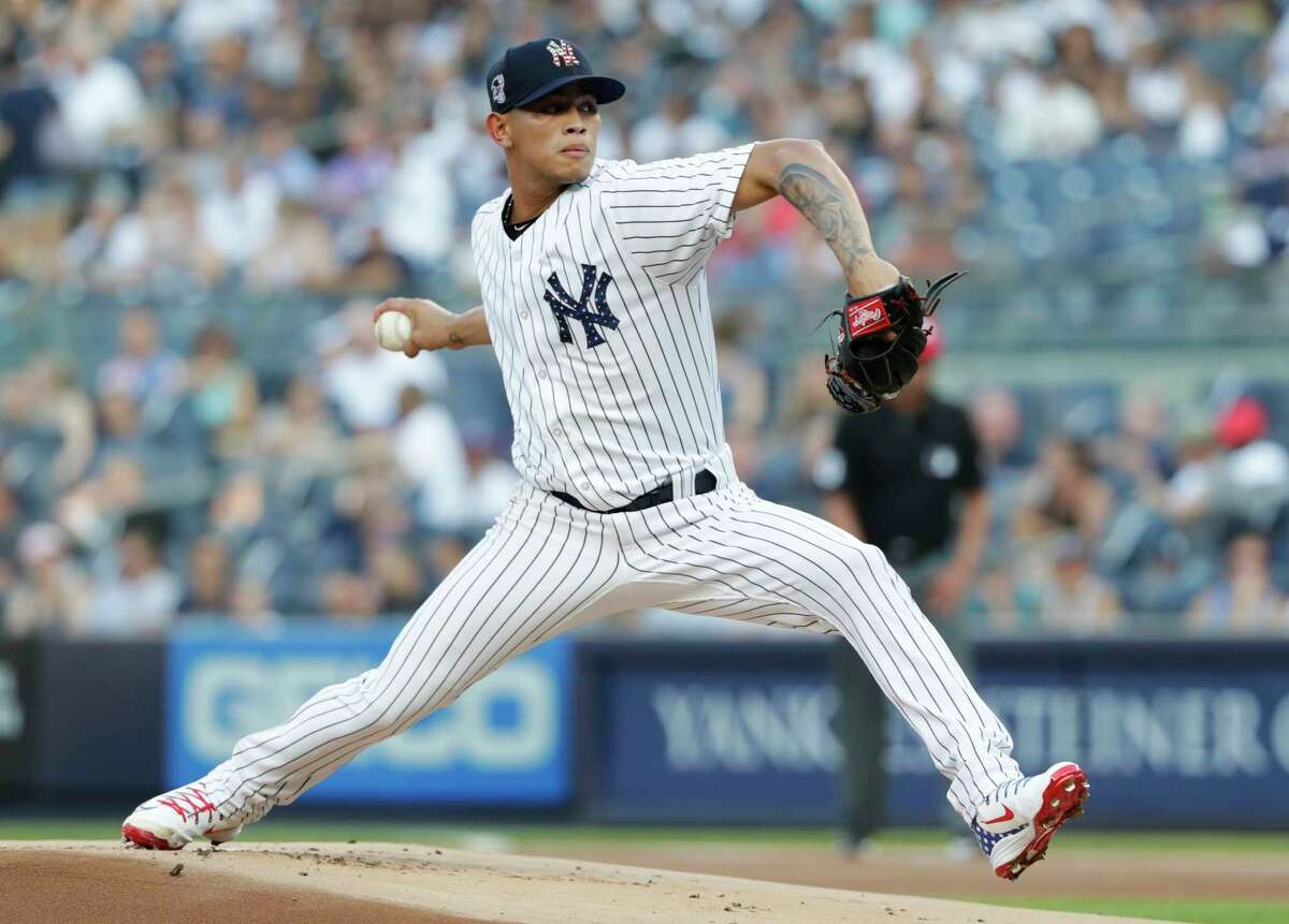 New York Yankees' Jonathan Loaisiga delivers a pitch during the first inning of a baseball game against the Atlanta Braves Monday, July 2, 2018, in New York. (AP Photo/Frank Franklin II)