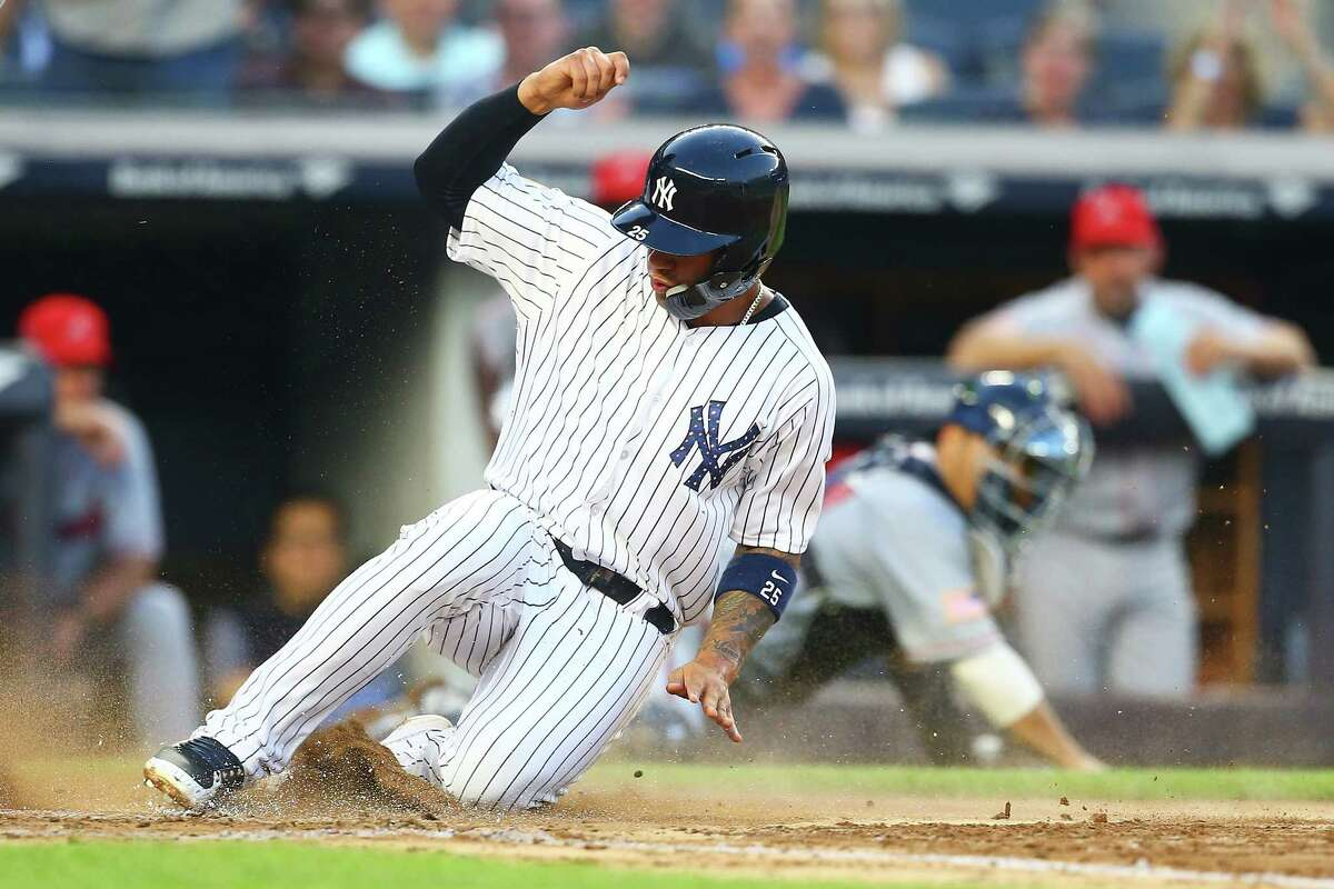 NEW YORK, NY - JULY 02: Gleyber Torres #25 of the New York Yankees score on a wild pitch in the bottom of the third inning against the Atlanta Braves at Yankee Stadium on July 2, 2018 in the Bronx borough of New York City. (Photo by Mike Stobe/Getty Images)