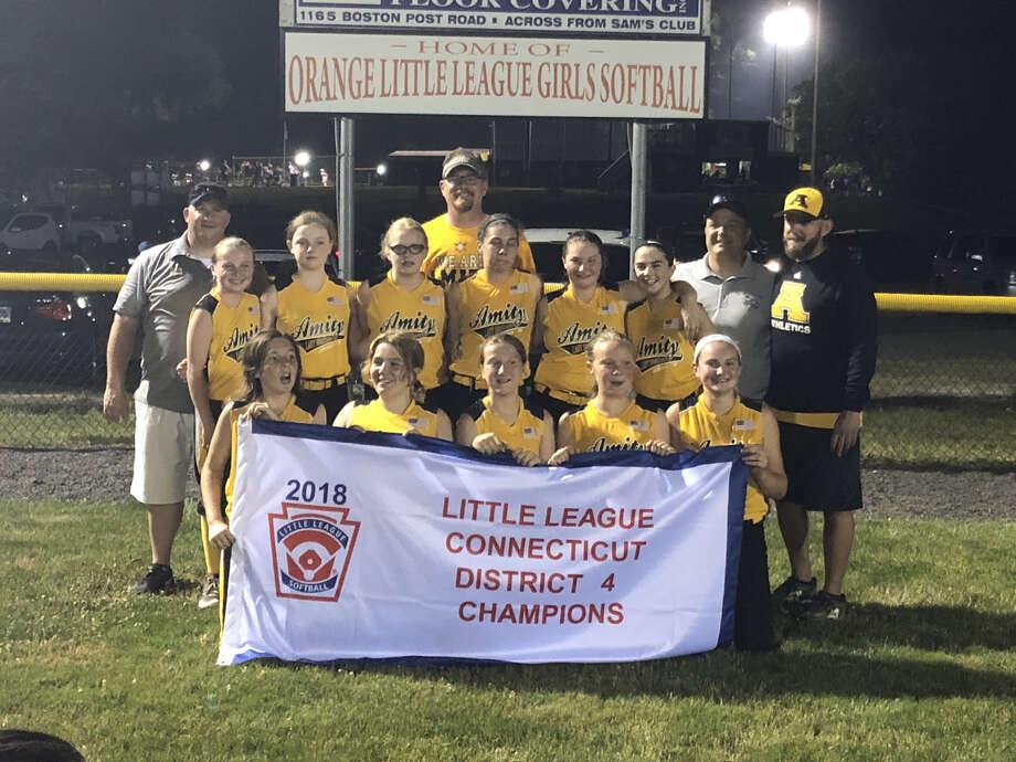 Amity celebrates its District 4 Little League softball title on Monday, July 2, 2018.