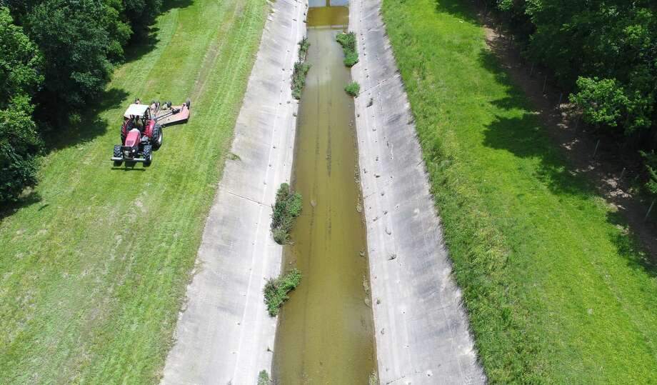 Drainage District 6 employees clear out a channel near Major Drive and Peveto Road in Beaumont Monday. DD6 Chief Engineer Doug Canant said the organization is running routine maintenance to keep drainage running. Photo taken Monday, 7/2/18 Photo: Guiseppe Barranco/The Enterprise