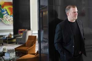 Landry's Inc. CEO Tilman Fertitta takes a look at the framing possibilities for the artwork located on the lobby of The Post Oak Hotel, Wednesday, March 14, 2018, in Houston.