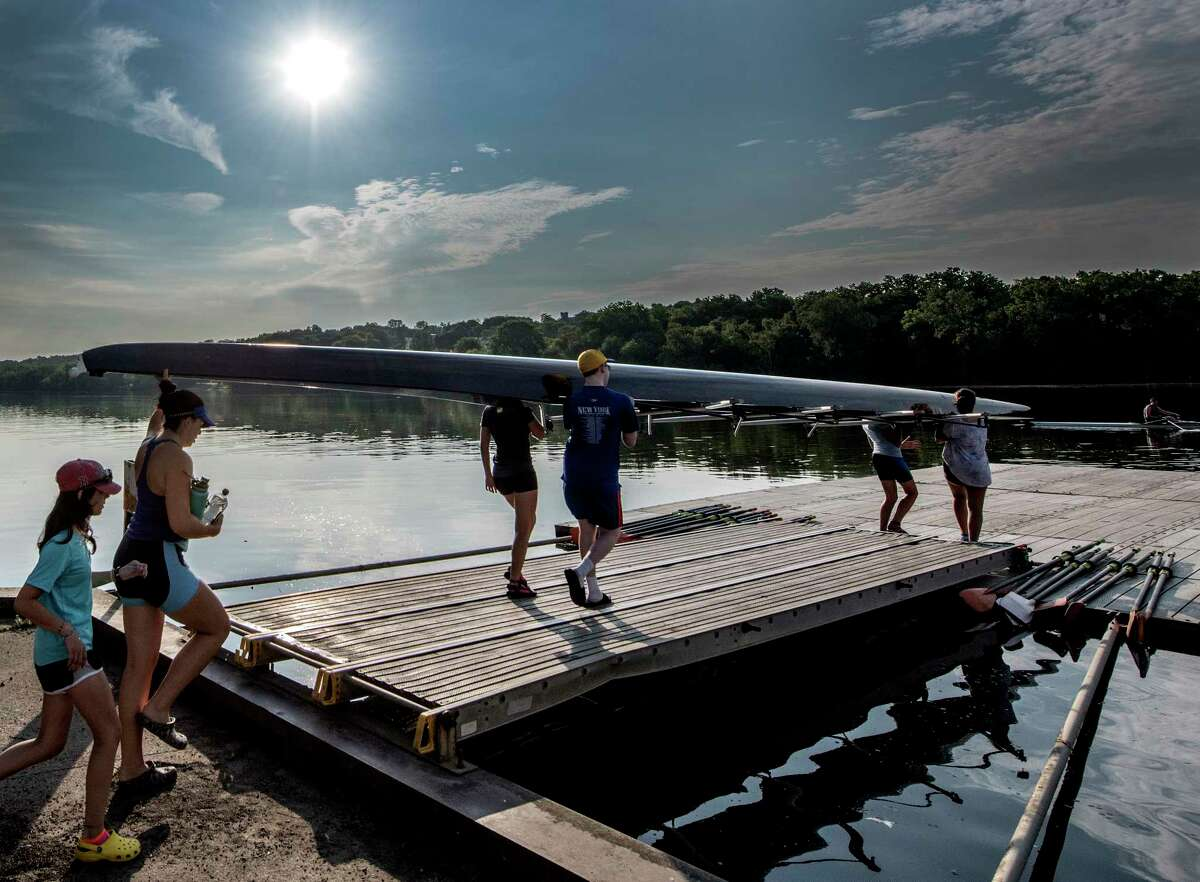 Juniors members of the Albany Rowing Center based under I 787 carry their boats to the water of the Hudson River for the second wave of training, this time for Junior members before the heat of the day sets in early Tuesday July 3, 2018 in Albany, N.Y. (Skip Dickstein/Times Union)