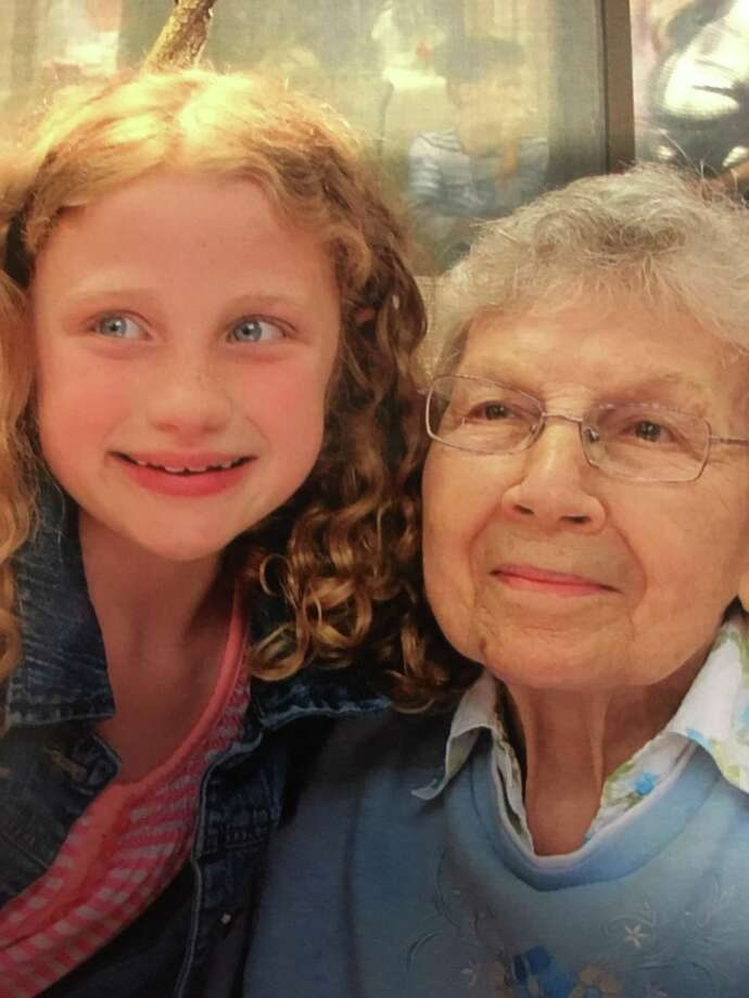 Pen pals Julia Bender and Betty Johnson share a tender moment together. Photo: Courtesy Of Candlewood Valley Health & Rehabilitation Center / The News-Times Contributed