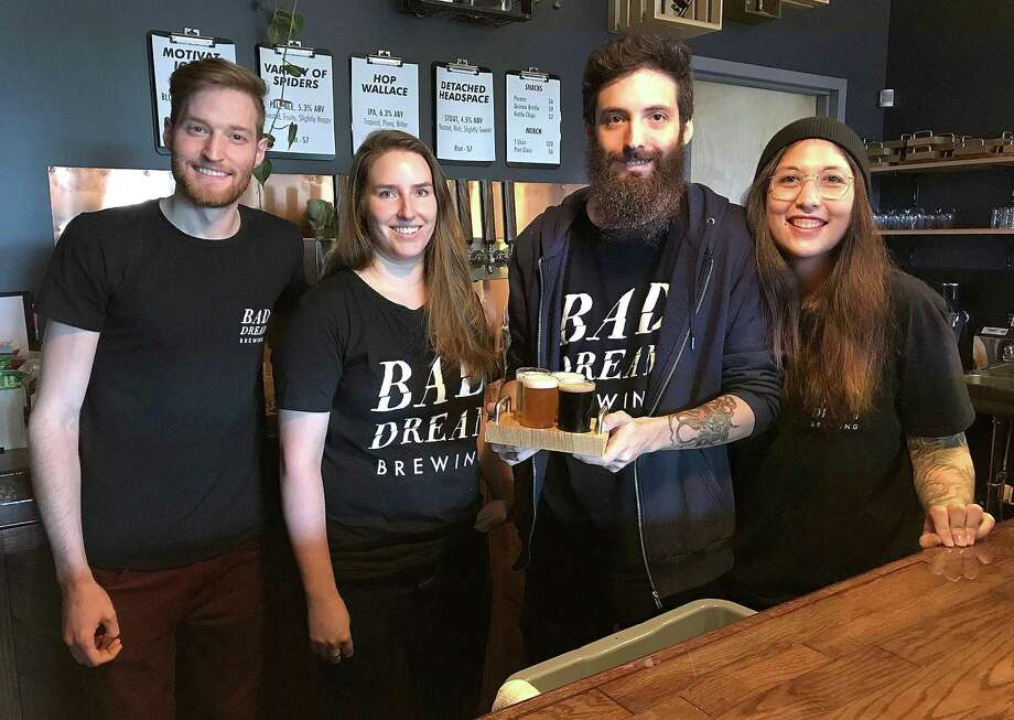 Bad Dream Brewing owners Brian Benzinger, Emily Leone, Max Retter and Michelle Retter stand behind the bar at their newly opened taproom at 116 Danbury Road (Route 7) in New Milford. Photo: Chris Bosak / Hearst Connecticut Media / The News-Times