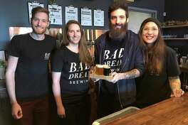 Bad Dream Brewing owners Brian Benzinger, Emily Leone, Max Retter and Michelle Retter stand behind the bar at their newly opened taproom at 116 Danbury Road (Route 7) in New Milford.