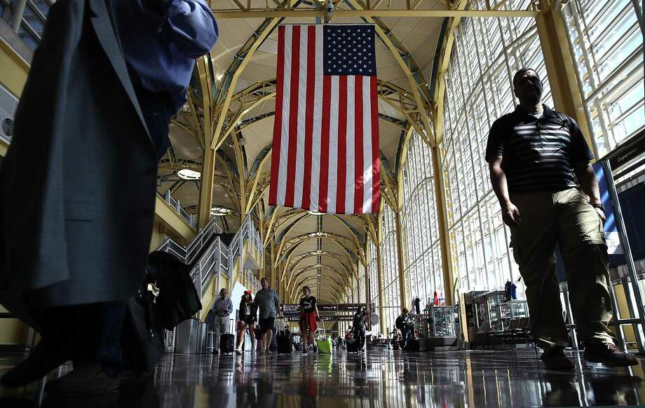 WASHINGTON, DC - JUNE 29:  Travelers walk to their gates in the concourse of Reagan National Airport in advance of the Fourth of July holiday on June 29, 2018 in Washington, DC. TSA has projected that 28.3 million passengers may be expected on the travel dates of June 28 through July 9, with 2.7 million passnegers expected today alone.  (Photo by Win McNamee/Getty Images) Photo: Win McNamee / Getty Images / 2018 Getty Images
