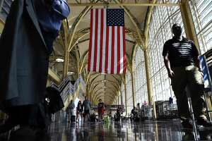 WASHINGTON, DC - JUNE 29:  Travelers walk to their gates in the concourse of Reagan National Airport in advance of the Fourth of July holiday on June 29, 2018 in Washington, DC. TSA has projected that 28.3 million passengers may be expected on the travel dates of June 28 through July 9, with 2.7 million passnegers expected today alone.  (Photo by Win McNamee/Getty Images)