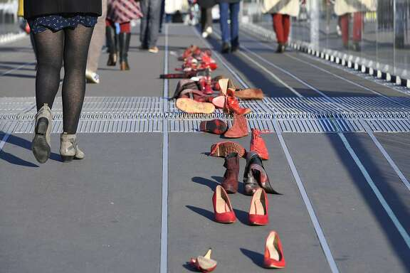 (FILES) This file photo taken on November 25, 2017 shows red-painted shoes, symbolising all the women victims of domestic violence, harassment, rape, sexual assault or feminicide, during a demonstration near the courthouse of Nantes during the International Day for the Elimination of Violence Against Women. Mexican journalist Mariana Zacarias was sexually harassed three times in only 15 days in Moscow, while doing her job during the 2018 Russia World Cup.  / AFP PHOTO / DAMIEN MEYERDAMIEN MEYER/AFP/Getty Images