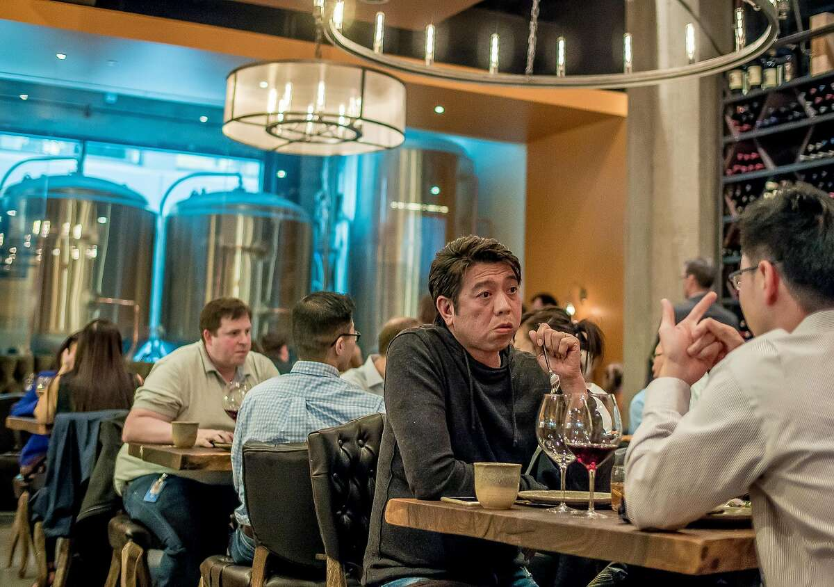 Diners eat dinner at Dirty Water in San Francisco, Calif., on August 20th, 2015.