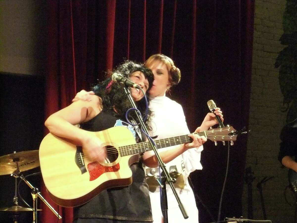 Erin Harkes, dressed as Melanie Krahmer of Sirsy, and Melanie, dressed as Princess Leia from Star Wars, at a Halloween show in 2011. (Photo by Neil Daley)