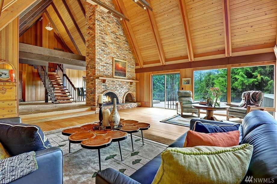 With soaring ceilings and a double lot, this Mercer Island abode is a unique property, asking 1.95M Photo: Photos By Erica Anderson - Vista Estate Imaging Via Coldwell Banker Bain
