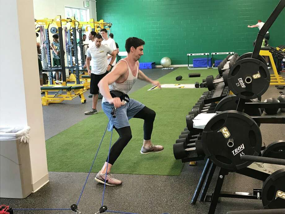 Former Siena forward Ryan Rossiter works out with the current players on Friday, June 29. (Mark Singelais/Times Union)