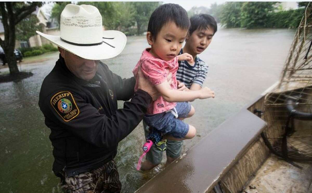 Members of the Fort Bend County Sheriff's Office worked long hours rescuing evacuees.