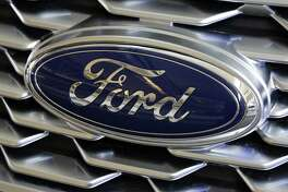 This Feb. 15, 2018, file photo shows a Ford logo on the grill of a 2018 Ford Explorer on display at the Pittsburgh Auto Show. A nonprofit auto safety advocacy group is asking Ford to recall 1.35 million Explorer SUVs due to continued complaints of exhaust fumes in the passenger compartments.
