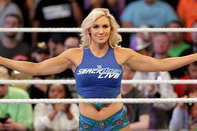 Charlotte Flair enters the ring before the match against Alexa Bliss during the WWE Survivor Series held at the Toyota Center in Houston, TX, Nov. 19, 2017. (Michael Wyke / For the  Chronicle)