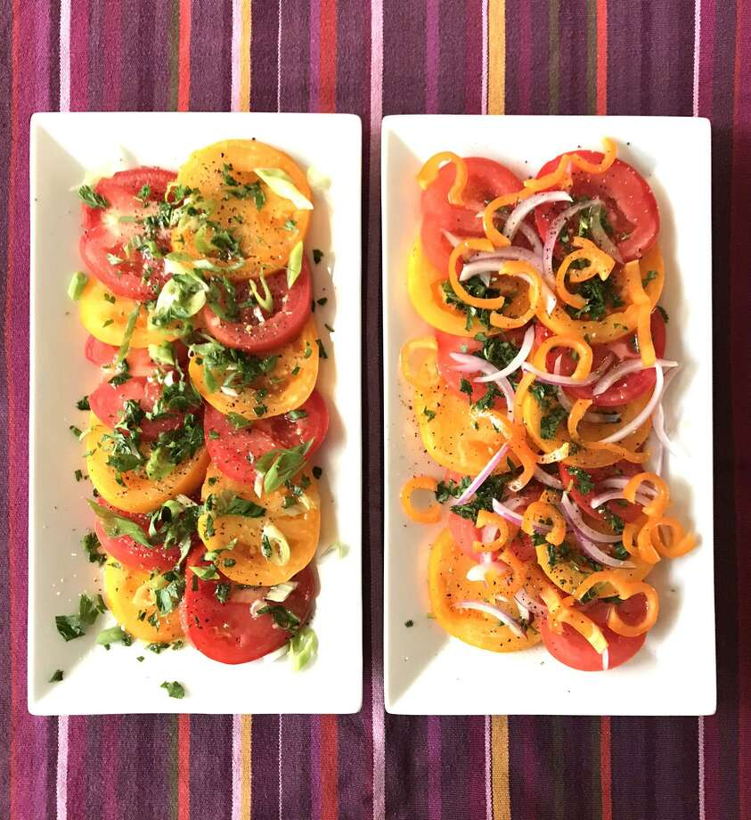 A great summer salad is as easy as slicing some tomatoes, topping them with herbs, onions or peppers and drizzling that with a vinaigrette. Left: tomatoes topped with green onions and chopped parsley. Right: Tomatoes topped with sliced red onion, Dulce Mediterraneo pepper and cilantro. Photo: Emily Spicer /San Antonio Express-News